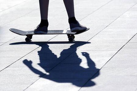 legs of a man rolling on a roller Board