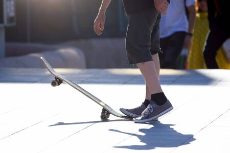 young people riding on a skateboard
