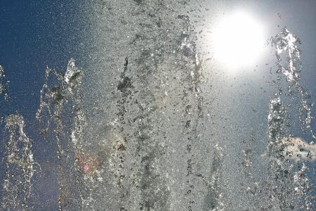 drops of the fountain in the setting sun