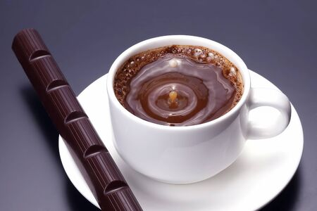 white cup with black coffee and chocolate on the saucer Reklamní fotografie
