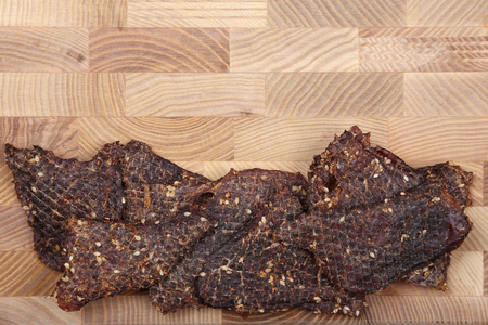 dried beef slices in spices with sesame seeds
