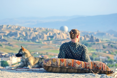 man with a dog watching the beauty of nature in Cappadocia. Turkey Stock Photo