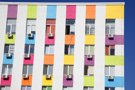 colored facade of a residential building with air conditioning