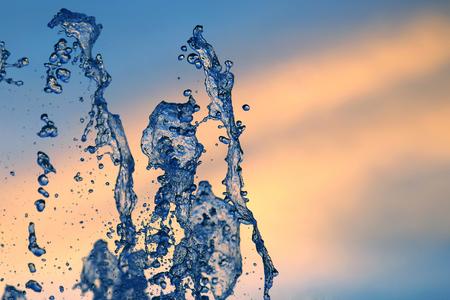 drops of the fountain in the setting sun Archivio Fotografico