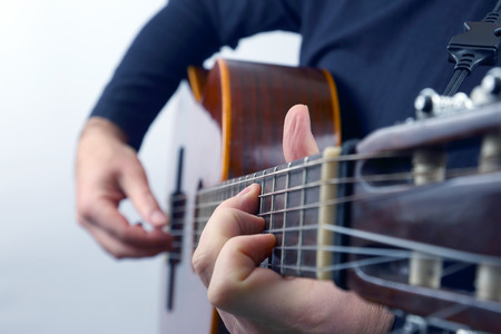 hands of the musician playing on classical guitar