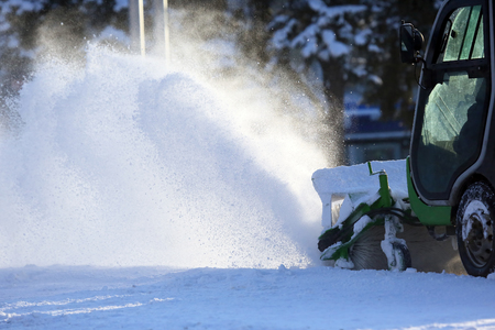 Special snow machine clears snow on the city street Stock fotó