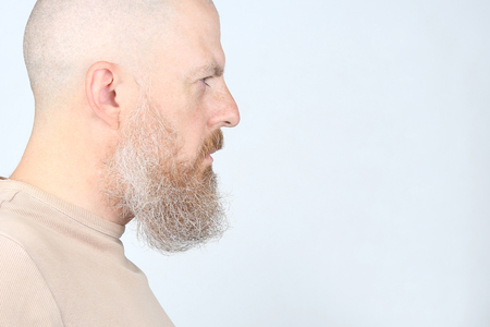 portrait of a serious bearded man in profile Stock Photo