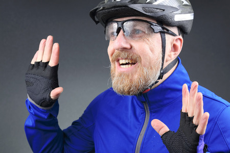 portrait of happy laughing bearded cyclist