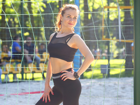 beautiful sports girl standing near the sports complex