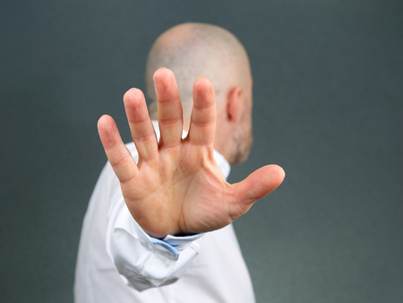 man negative hand gesture and turned away