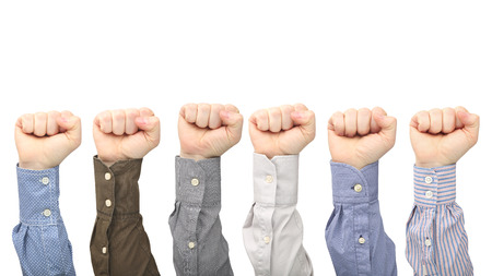 Male hands in fists in different shirts on white background. Protest and indignation. Hand gesture signals Banco de Imagens - 122277524