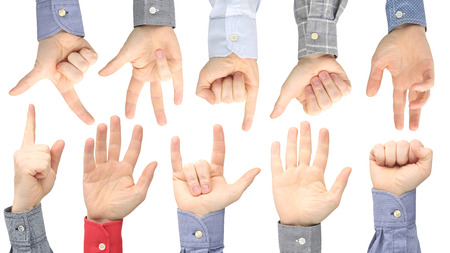 Raised hands of different men on white background. Showing the signs of the fingers to express emotions. Sign language hands