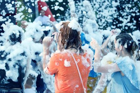 man in a soapy foam at the festival disco Banco de Imagens