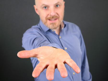 man is pulling forward the open hand