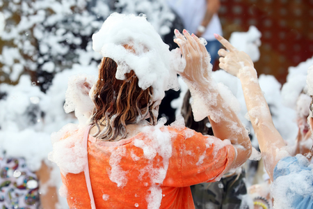 girl in soap foam at the concert
