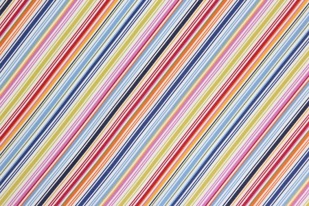 The background texture of the fabric in a colored diagonal stripe Imagens