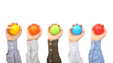 Mens hands with colorful plastic balls on white background