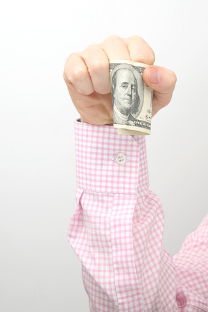 Hand with outstretched money bills. Financial operations. Business relationship Stock Photo