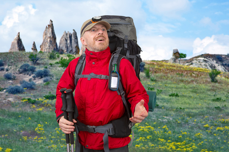Happy tourist with backpack is traveling in the highlands