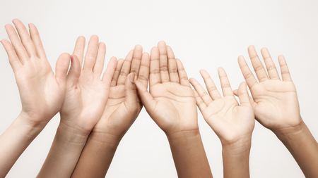 many raised hands in a row. Body language in relationships of friends and companies