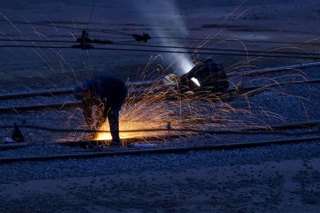 workers welders repair metal rails. industry and repair of transport hubs Banco de Imagens