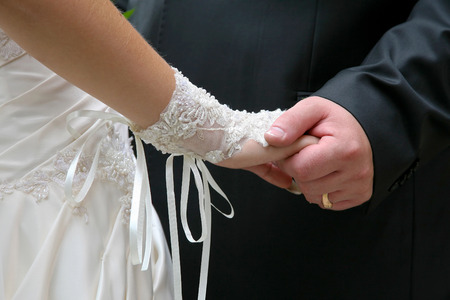 the groom holds the brides hand close up. relationship of a married couple in love Stock Photo