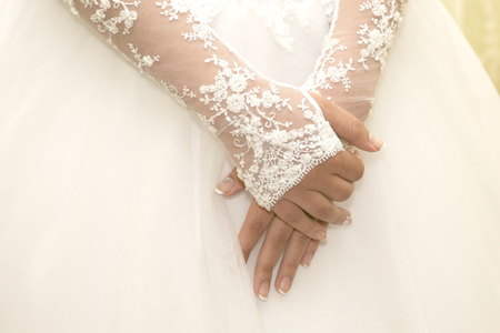 bride had folded her hands in front of him. beauty and fashion in womens clothing