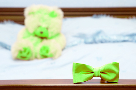 the male butterfly is on the back of the bed on the background of the bear. items for festive ceremonies