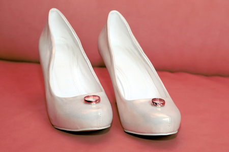 bride wedding shoes with rings. happy holiday