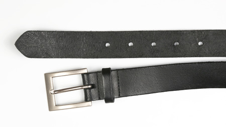 black leather belt on white background. items of clothing and equipment Reklamní fotografie