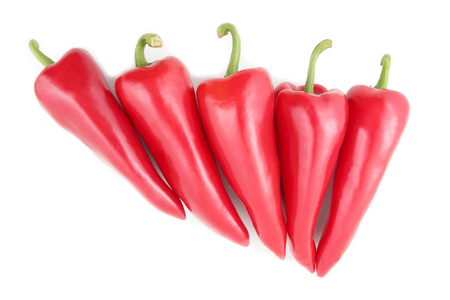 the five bright red sweet peppers on a white background. healthy fresh vegetables and food Imagens