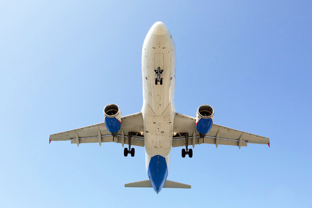 passenger jet flies in for a landing. commercial airline