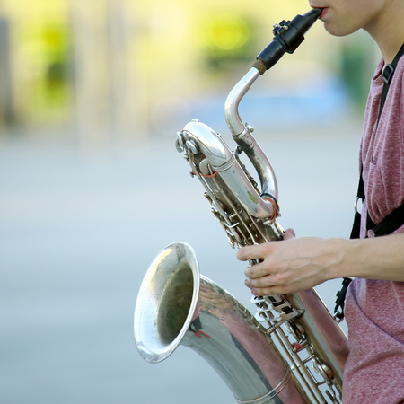 male musician playing saxophone on the street. music and creativity. jazz and Blues