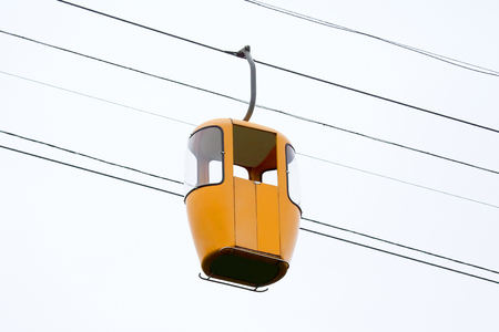 Yellow cab of the cable car at the height. high-altitude transport for delivery of people in the mountains