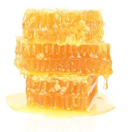 honeycomb on white background. useful vitamin food Foto de archivo