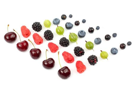 many different juicy berries are arranged in order on a white background. healthy fresh vegetables and food Archivio Fotografico