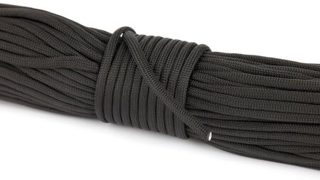 coil of dark rope paracord on a white background Stock Photo