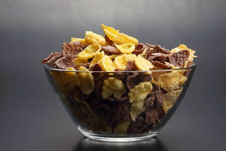 colored corn flakes in a bowl. raw flour food 스톡 콘텐츠