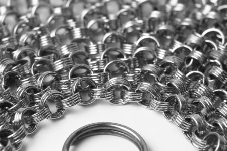 the ring is surrounded by a large number of chain on a white background. everyday tools