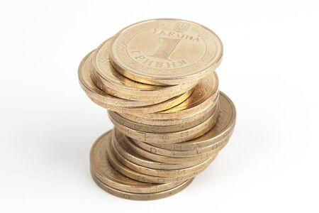 stack of Ukrainian coins on the white background. financial growth and welfare of the country