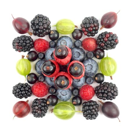 different berries in the form of a square on a white background. healthy fresh vegetables and food Imagens