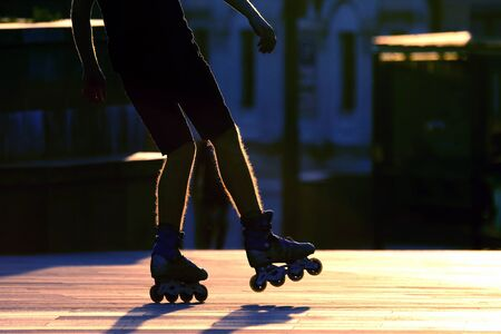 silhouette pairs of legs on roller skates. Hobbies, sports and recreation for young people