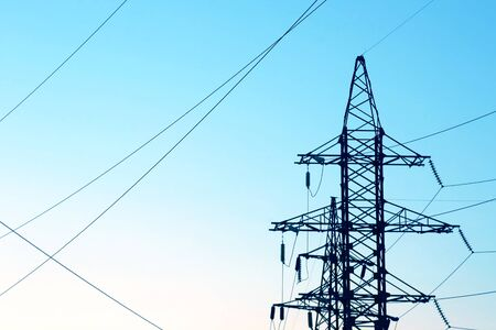 masts and wires on a background blue sky. industrial electrical industry