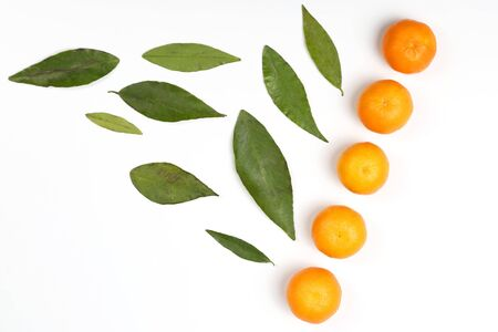 Mandarin with leaves on a white background.  healthy fresh vegetables and food