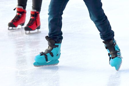 feet of different people skating on the ice rink. sports, Hobbies and recreation of active people