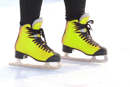feet in skates on an ice rink. sports, Hobbies and recreation of active people