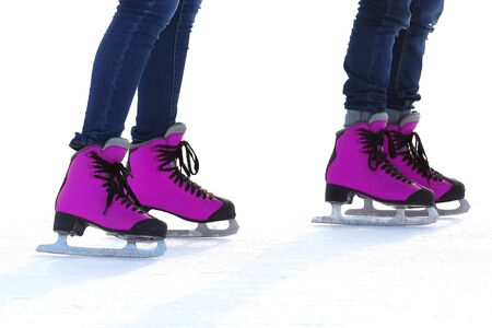 Female legs in skates on an ice rink. sports, Hobbies and recreation of active people