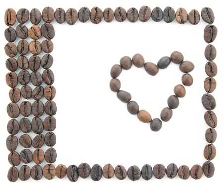 frame made of coffee beans on white background. creativity and manual work Imagens