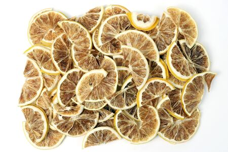 the dried lemon slices closeup on white background. useful vitamin health food