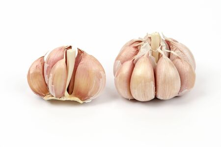 heads of garlic on a white background. healthy fresh vegetables and food